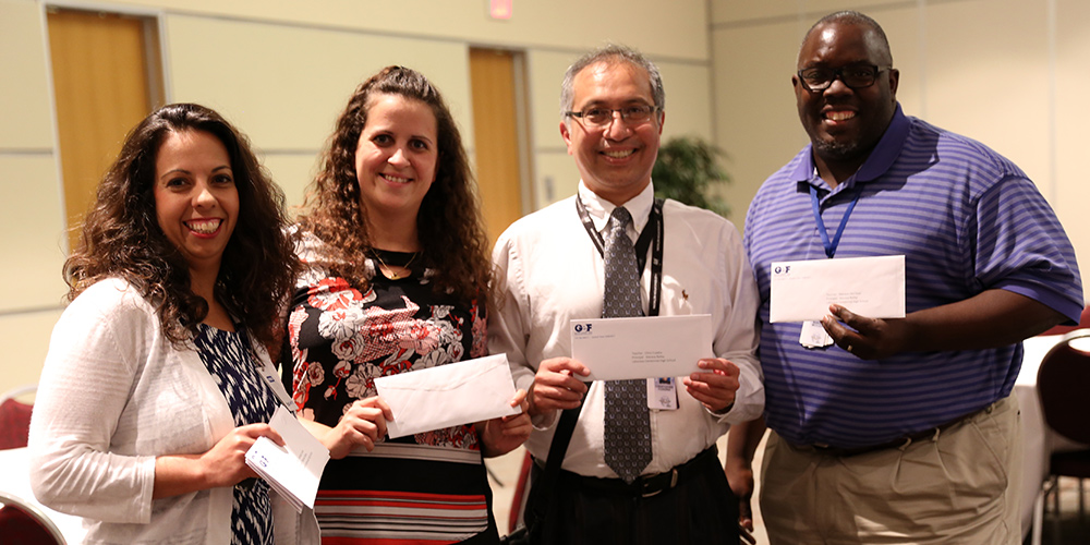 Ecolab award winners hold up their Visions for Learning Grants