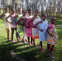 "African children show off their dresses created by ""Sew Much Fun"" club."