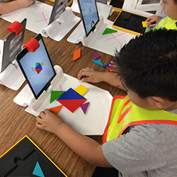 Student learns using the Osmo