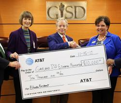 AT&T presents the Garland Education Foundation with ten thousand dollar check.