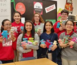 "Brandenburg Middle School students pose with their ""Sew Much Fun"" creations"