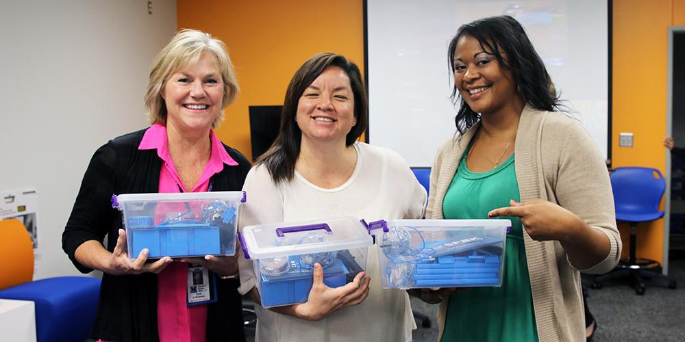 Teachers receive their Sphero Robotic Balls from the Garland Education Foundation
