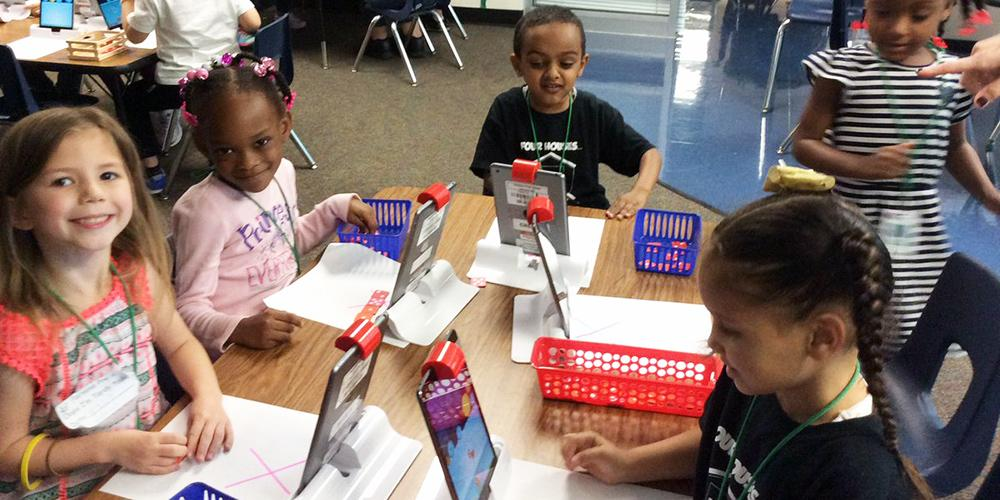 Parsons Pre-K students interact with the Osmos learning system